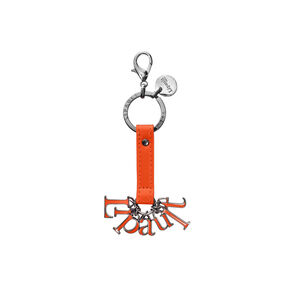 Lipault Plume Accessories Bag Charm - Letters in the color Orange.