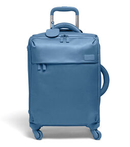 Lipault Original Plume Spinner 55/20 Carry-On in the color Steel Blue.