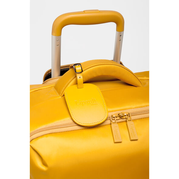 Lipault Original Plume Spinner 65/24 Packing Case in the color Mustard.