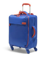 Lipault Original Plume Spinner 55/20 Carry-On in the color Electric Blue/Flash Coral.