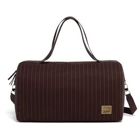 Lipault Jean Paul Gaultier Ampli Duffle Bag in the color Burgundy.