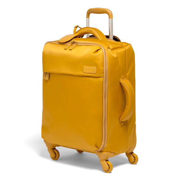 Lipault Original Plume Spinner 55/20 Carry-On in the color Mustard.